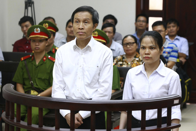 Vietnamese prominent blogger Nguyen Huu Vinh, left, and his colleague Nguyen Thi Minh Thuy stand at the dock during their trial at the Higher People¿s Court ...