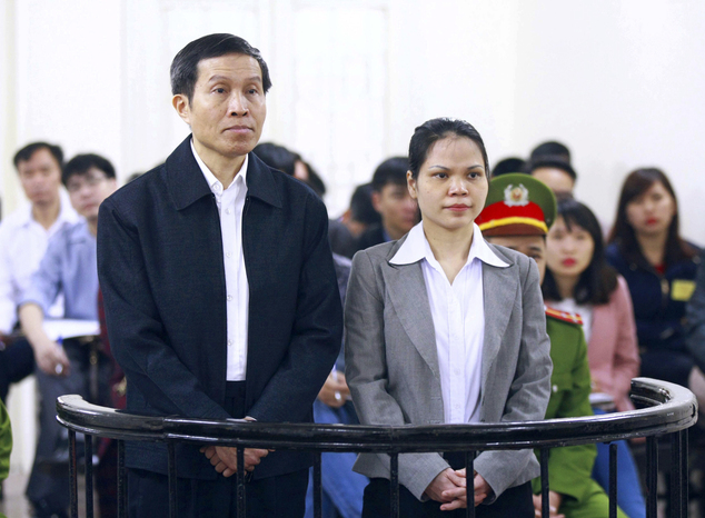 FILE - In this March 23, 2016 file photo, Vietnam's prominent blogger Nguyen Huu Vinh, left, and his assistant Nguyen Thi Minh Thuy stand together during a t...