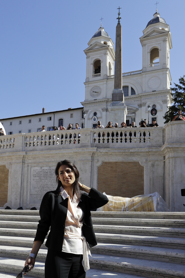 Rome's mayor Virginia Raggi poses for photographers in front of the world-famous Spanish Steps before the start of a press conference to present the reopenin...