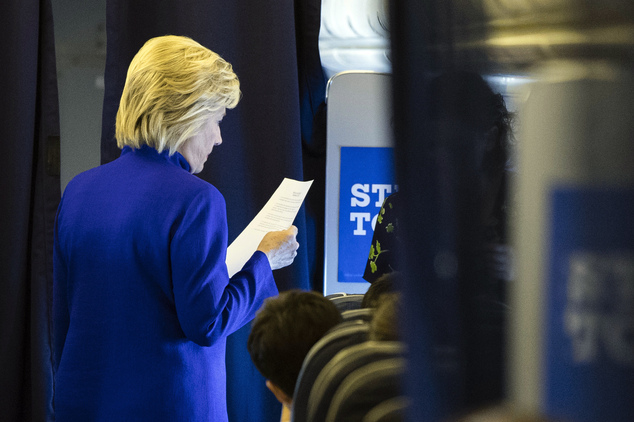 Democratic presidential candidate Hillary Clinton meets with members of her staff onboard her campaign plane en route to Westchester County Airport in White ...