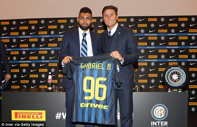 The Brazilian stands alongside club legend and now vice president Javier Zanetti in Milan