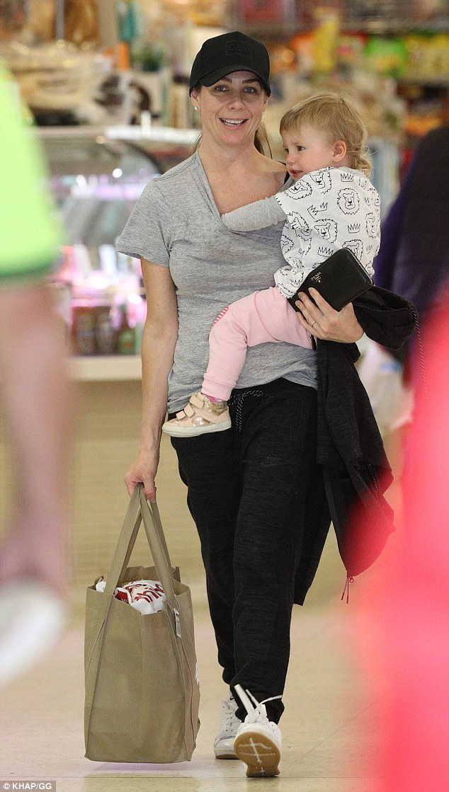 Mother-daughter time: Kate Ritchie, 38, was pictured wearing her wedding ring following ongoing rumours of a split with husband Stuart Webb, during shopping trip in Sydney with daughter Mae recently