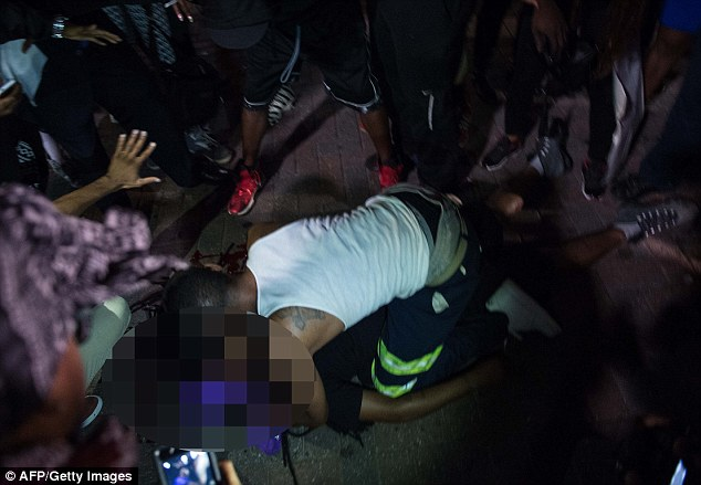 Carr was shot as protesters clashed with police in riot gear lined arm-in-arm protecting the Omni Hotel at about 8.30pm