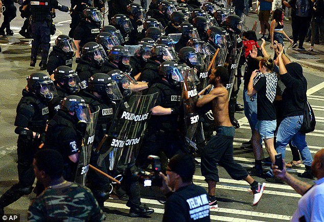 A peaceful protest turned into a riot in Charlotte on Wednesday night as demonstrators clashed with police in riot gear