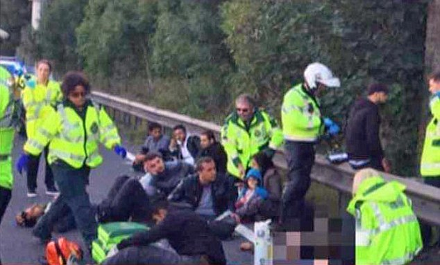 Sixteen people have been detained after police received reports of immigrants in a lorry travelling on the M1