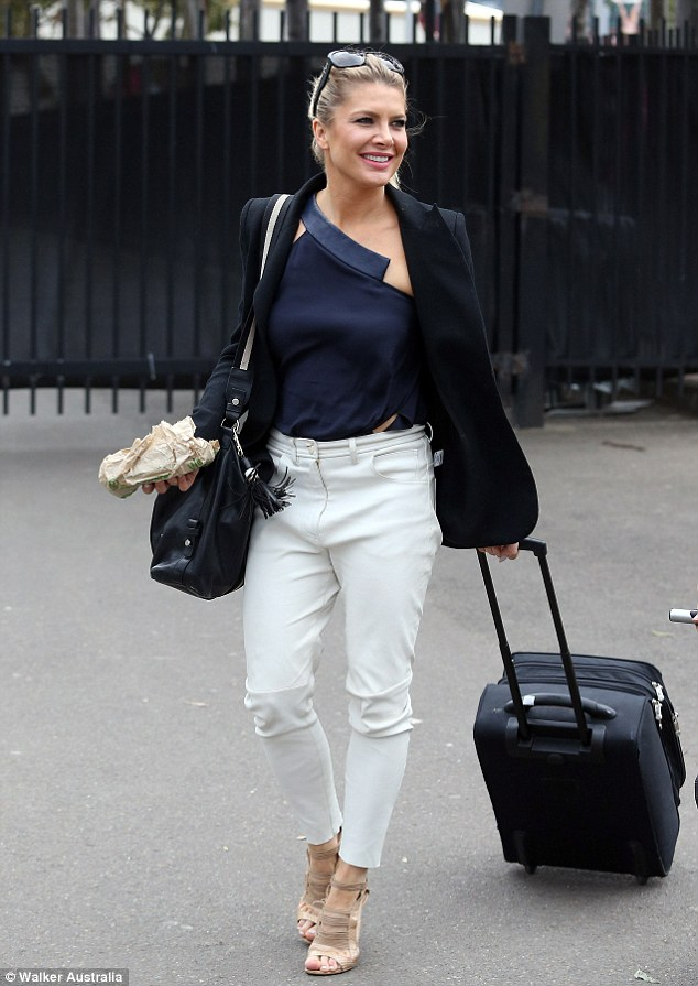 Looking good! The 41-year-old put on a stylish display in cropped white trousers and strappy heels as she arrived at the exhibition to represent her childrenswear range Chi Khi