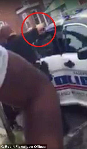Ficker, retained by the mother, posted a bystander's cellphone video on Facebook on Tuesday