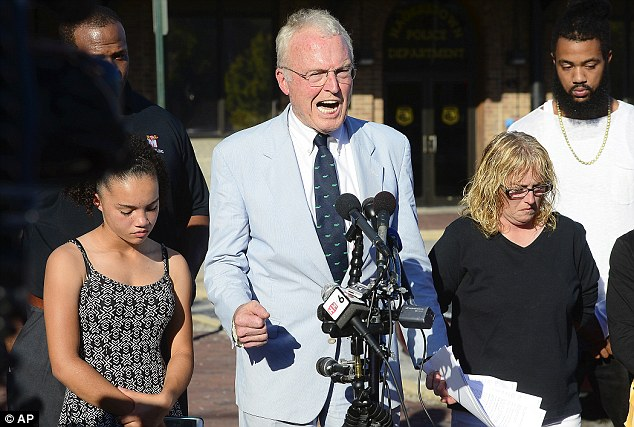 Attorney Robin Ficker, center, is pictured while speaking at a press conference at the Hagerstown Police Department parking lot on Thursday