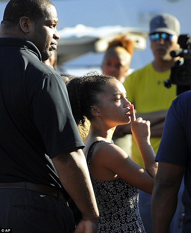 The teen appears to silence demonstrators during the press conference on Thursday
