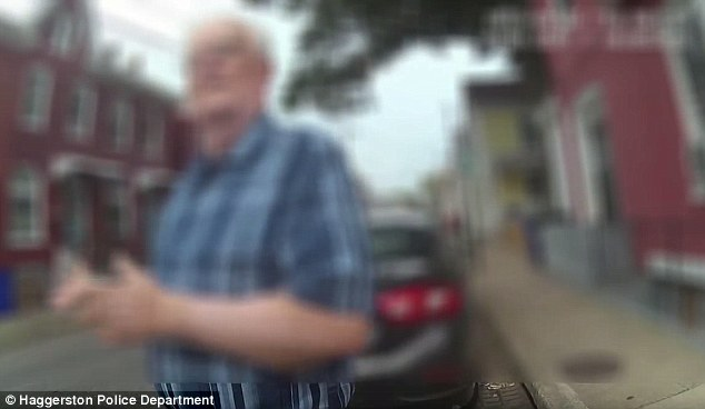 In the video, the car's driver (pictured) tells an officer that she rode through a red light, and points out several scratches on his car door