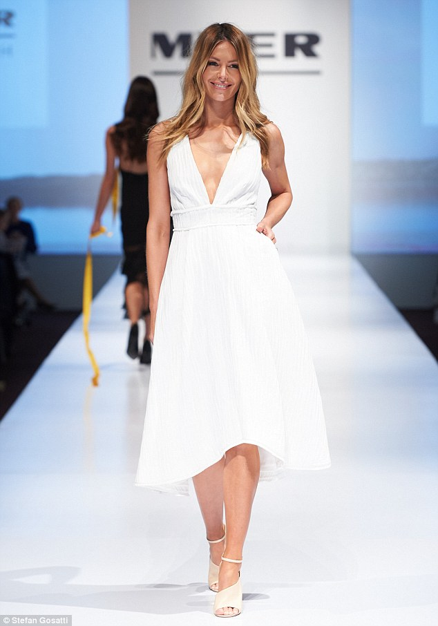 Svelte: Jennifer took to the runway in another flirty white frock, but this time with the hemline finishing mid-calf