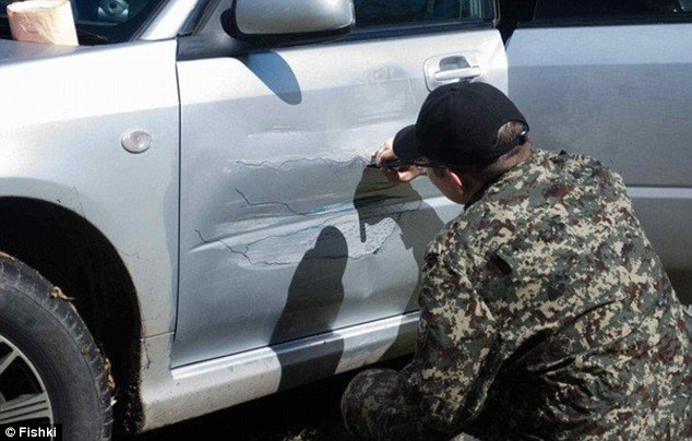 The driver, Subarika, enlisted the help of artist Aleksandr Vladimirovich - who spent two hours camouflaging the dent on the Subaru Impreza with the ingenious design.
