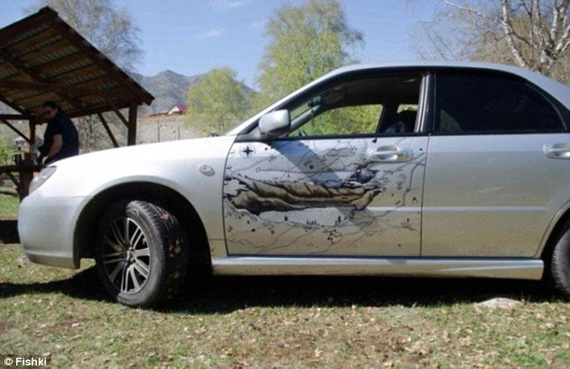 A Russian artist transformed a dented car into a map of the Altai Mountains - where Russia, China, Mongolia, and Kazakhstan come together