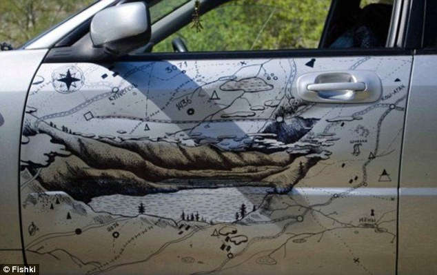 Aleksandr shaded in the deep scratches with the black pen to give the impressions of the dramatic mountain range and even added in details of a lake and surrounding roads