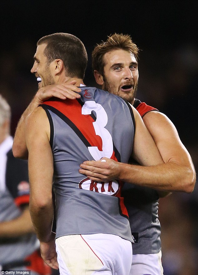 Jobe Watson celebrates with Essendon Bombers team-mate Scott Gumbleton (left) during a game against St Kilda in 2013