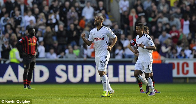 Luke Moore celebrates scoring the game's only goal in Swansea City's sole Premier League win over Manchester City, which came at the Liberty Stadium in March 2012