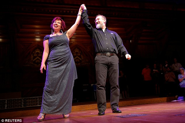 NASA scientists Lisa Danielson (left) and Will Stepanov are celebrated onstage for their wedding anniversary during the Ig Nobel Prize ceremony at Harvard University in Cambridge