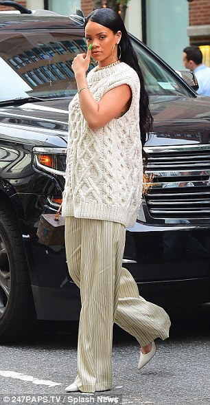 Chic: The outfit was decorated with sleek stripes and she added a smart pair of white pointed court shoes