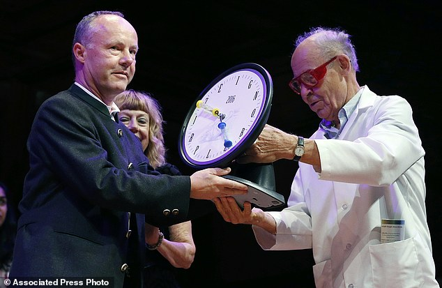 Fredrik Sjoberg, left, of Sweden, accepts the Ig Nobel award in literature from Nobel laureate Dudley Herschbach (chemistry, 1986). Sjoberg's research led him to publish three volumes about collecting hoverflies on the sparsely populated Swedish island where he lives