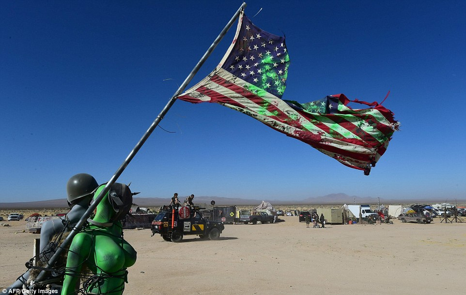 Festival goers are tied together with a ripped up American flag, representing thepost-apocalyptic world