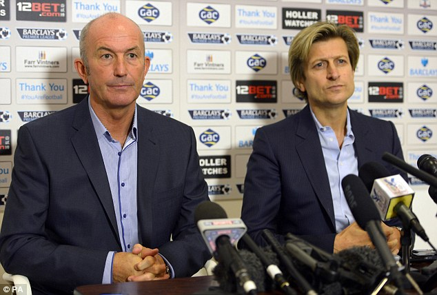 Pulis during his unveiling as Crystal Palace manager alongside chairman Steve Parish