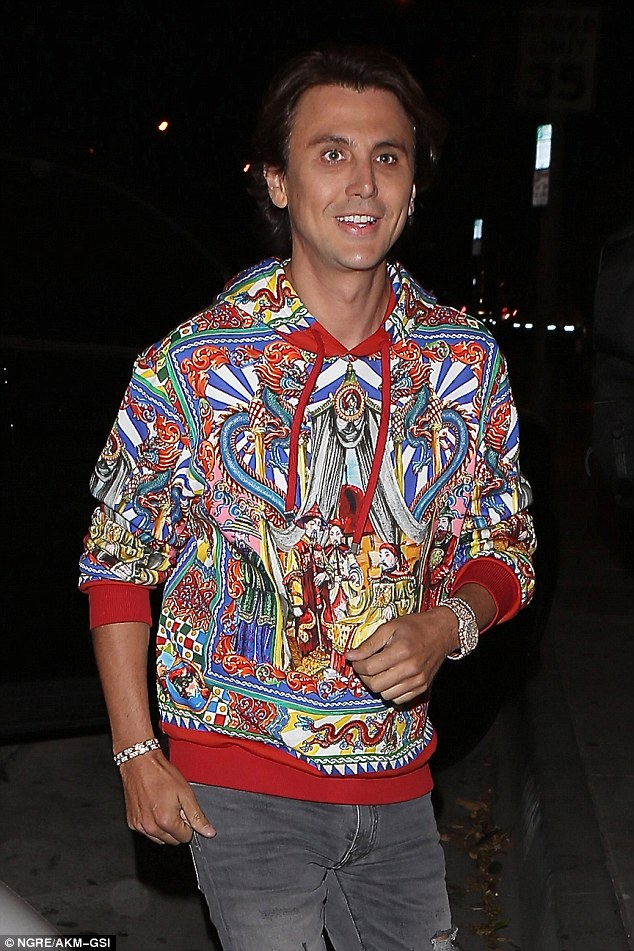 Bright idea: The reality star had on a multicolored top by Dolce & Gabbana