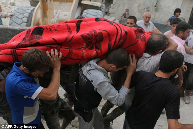 Syrians carry a body following bombardment on the al-Marja neighbourhood of the northern Syrian city of Aleppo