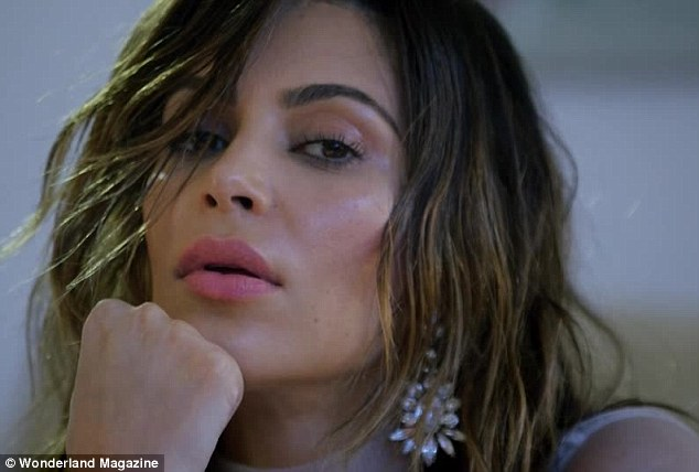 The lips! Kim Kardashian is shot in close up for a video clip from Wonderland magazine released on Friday