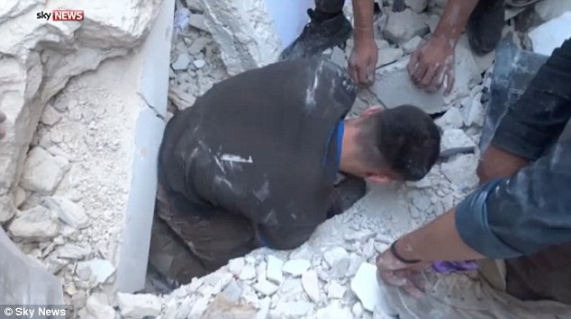 She could be heard crying out in pain in the video footage as rescuers desperately worked to remove the rubble