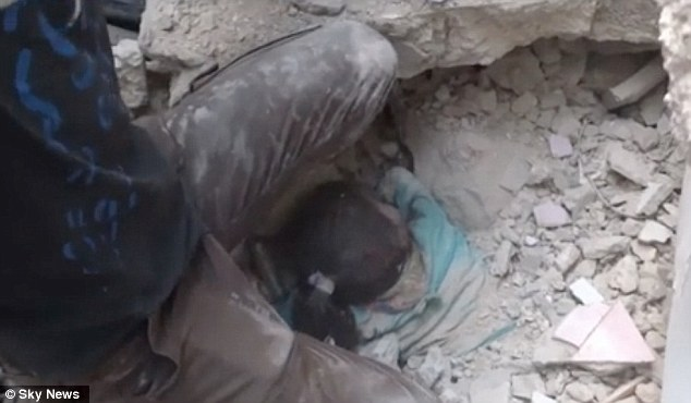 A five-year-old girl was pulled alive from the wreckage of a collapsed building after an airstrike in Aleppo which claimed the lives of her family