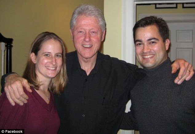 Silent man: Bryan Pagliano, whose wife Carrie was with him to pose with Bill Clinton, asserted Fifth Amendment rights to avoid FBI questioning and has refused to testify to Congress