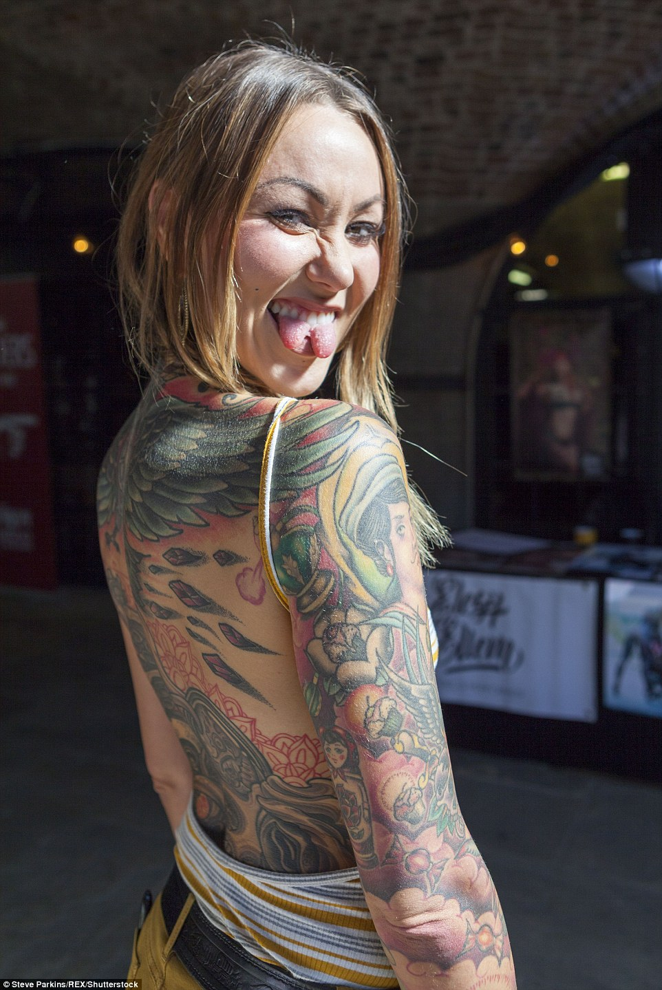 Swedish model and burlesque performer Elegy Ellem proudly shows off her extensive tattoos - and her split tongue