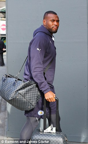 Foxes captain Wes Morgan carries his bags