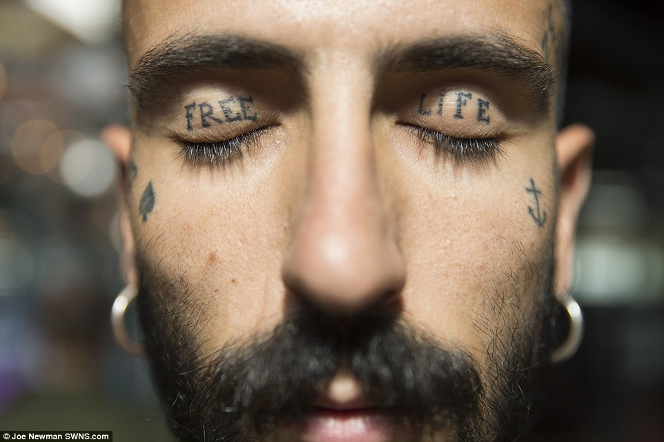 Blink or you'll miss it: Matteo Pasolini shows off his motto, tattooed on his eyelids. He's one of many exhibitionists on show