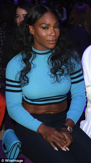 Front row fancy: Serena Williams wowed in an aquamarine cropped jumper teamed with skinny jeans and heeled boots