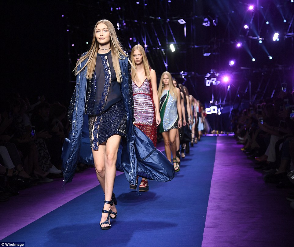 Leading the way: Gigi lead the glamorous brigade of models as they took to the catwalk to showcase the designs