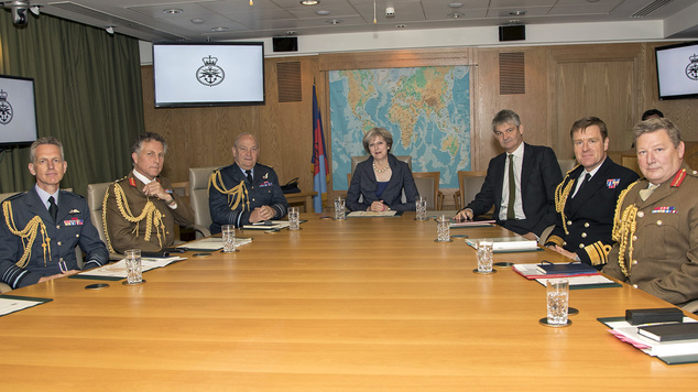 Prime Minister Theresa May with defence chiefs as she reiterated her commitment to crack down on vexatious legal claims against troops.