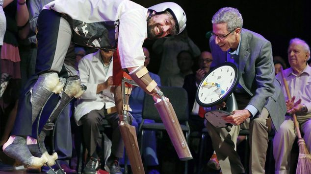 A British man who lived as a goat for three days is among the winners of this year's Ig Nobel prizes for scientific research. In this image, Thomas Thwaites, left, accepts the Ig Nobel prize in biology from 2007 economics laureate Eric Maskin at Harvard University
