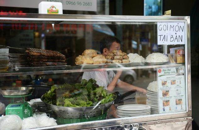 Grilled pork, spring rolls and rice noodles displayed at the entrance of the Bun Cha Huong Lien restaurant in Hanoi