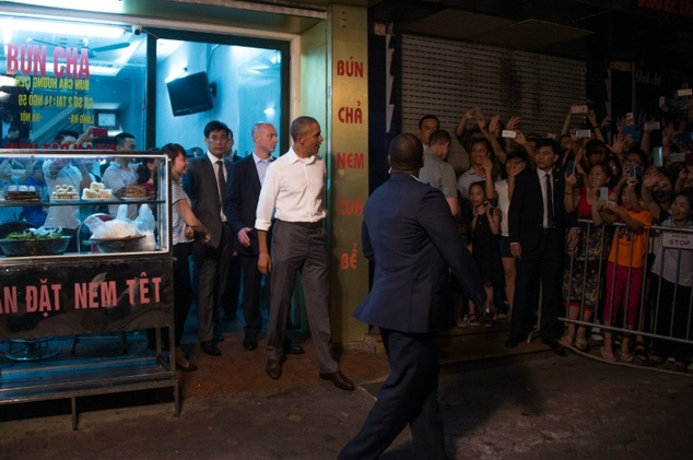 US President Barack Obama departs Bun cha Huong Lien with CNN's Anthony Bourdain in Hanoi on May 23, 2016