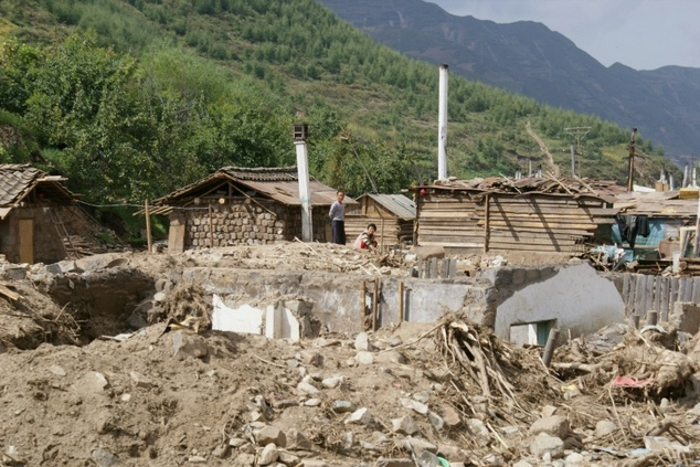 Heavily damaged homes due to the flooding of the Tumen river in late August 2016 in Haksan Ri, North Korea
