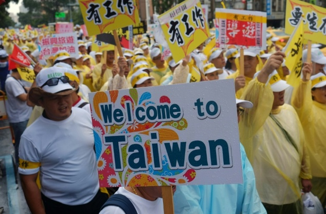Thousands of tourism industry workers took to the street in Taiwan September 12, demanding the government address a slump in visitors from China as cross-str...