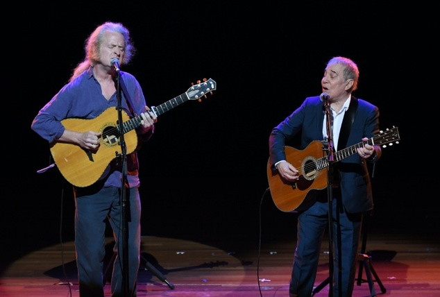 Paul Simon (R) performs onstage during Global Citizen: The World On Stage at NYU Skirball Center on September 22, 2016 in New York City