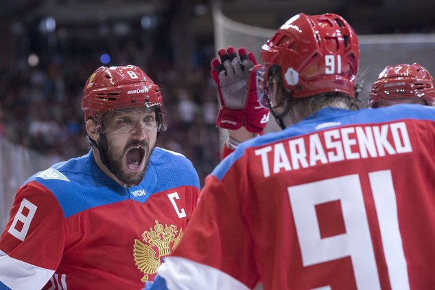 Team Russia's Alex Ovechkin, left, reacts as he celebrates with goal-scorer Vladimir Tarasenko after their first goal against Finland during the second perio...