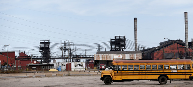 This Sept. 14, 2016 photo shows factories in East Chicago, Ind. The mayor of this industrial town ordered the evacuation of a 40-year-old public housing comp...