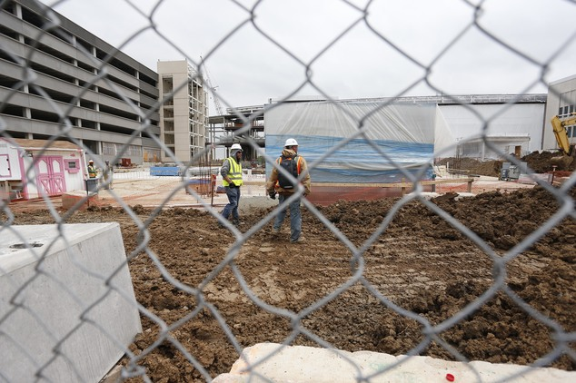 FILE - In this May 21, 2015 file photo, members of a construction crew work at the site of the Veterans Administration hospital complex under construction in...