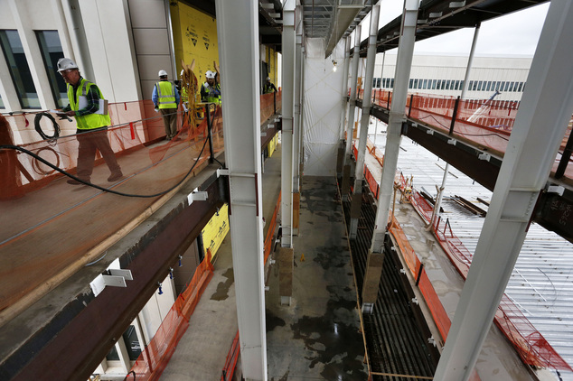 FILE - In this April 18, 2015 file photo, construction managers walk on the work site of the Veterans Administration hospital complex under construction in A...