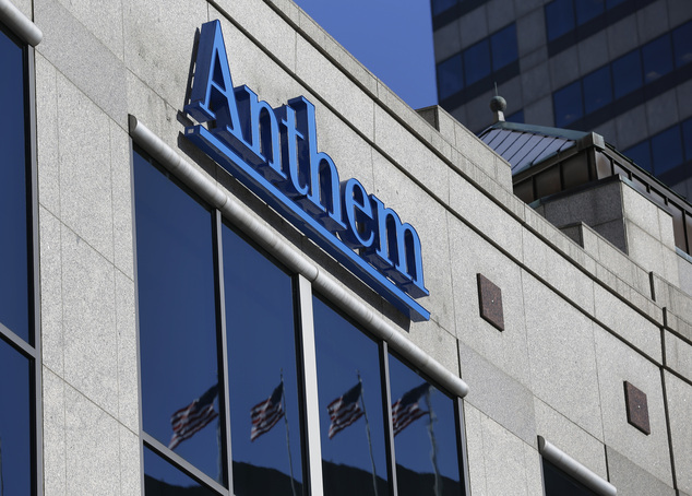 FILE - In this Thursday, Feb. 5, 2015, file photo, the Anthem logo hangs at the health insurer's corporate headquarters in Indianapolis. The Yahoo hack, repo...