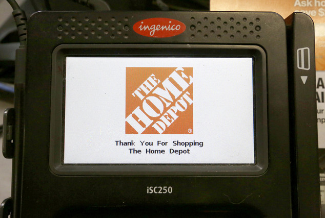 FILE - In this Wednesday, May 18, 2016, file photo, the Home Depot logo appears on a credit card reader at a Home Depot store in Bellingham, Mass. The Yahoo ...