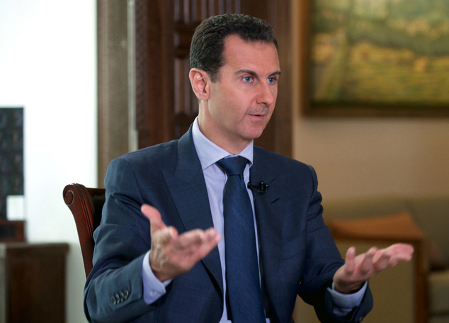 In this Wednesday, Sept. 21, 2016 photo released by the Syrian Presidency, Syrian President Bashar Assad speaks to The Associated Press at the presidential p...